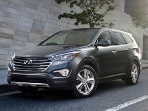 Hyundai Grand Santa Fe 2014 года выпуска: паркетный внедорожник нового поколения